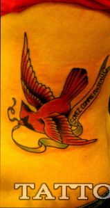 I really want a cardinal tattoo for my grandparents since that was their last name, but I can't find one I really love....this one is the one I like the most that I've found... minus the banner thing
