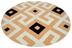 """An Abstract style hand tufted pure wool rug in ivory white, black and peach. Its has a pile depth of 12-14mm. Created using the """"alamo"""" design."""