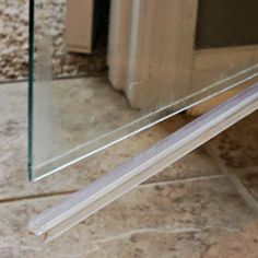 How to Clean the Plastic Strip at the Bottom of a Glass Shower Door!