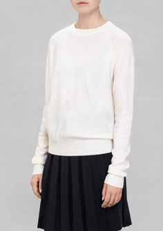 Crafted from soft, comfortable cashmere, this sweater has a clean design with asymmetrical rib-knitting along the bottom hem. Winter White, Cashmere Sweaters, Rib Knit, Knitwear, Ready To Wear, Clean Design, Blouse, Skirts, How To Wear