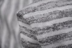 Grey/white strip marle 54% Viscose 46% Poly. Width:138cm This soft knit is perfect fo...