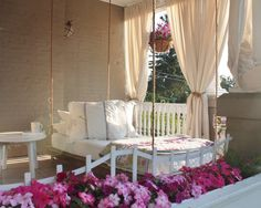 hanging porch daybed!!!! , rope or chains, slab of wood,  and old crib or twin mattress. I WILL be doing this...omw