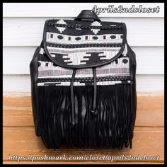 "❗️1-HOUR SALE❗️Boho Backpack Bag Tassel Fringe NEW WITH TAGS   Boho Large Backpack Bag  * Exterior is vegan leather like w/boho print fabric  * Top handle, adjustable back handles, & fold over flap w/magnetic snap & adjustable drawstring  * Interior wall zip, media, & smartphone pockets; Fringe & braided accents  * Approx. 14"" H x 13.5""W x 6.5""D  * Subtle structure Material: Canvas Cotton, PU, & polyester Color:Black Item:93900  No Trades ✅ Offers Considered*/Bundle Discounts✅ *Please use…"