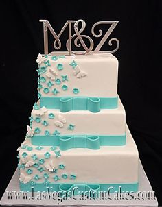 Turquoise Ribbon and Butterflies Cake... love the cake but the monograms have to go.
