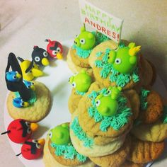 Angry Birds cookies stacked up to resemble a game setting. Pigs and angry birds are made of fondant.
