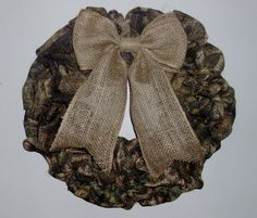 """18"""" Burlap Camouflage Wreath with Bow  This full camouflage burlap wreath with plain burlap bow is perfect for the hunting families out there or if you just LOVE camo!!!"""