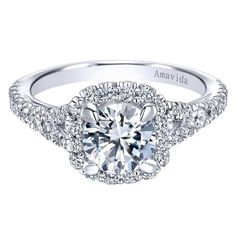 14kt white gold semi-mounting engagement ring, halo style, containing 0.65ctw of round brilliant cut diamonds, SI1 clarity, G-H color, shared prong set. The rin