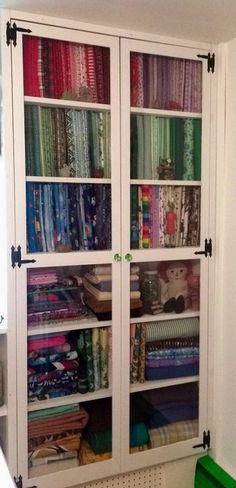 Would love to have a cabinet like tis one each side of the window in my craft room