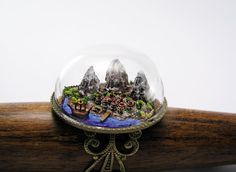 Exquisitely intricate miniature scene in glass dome ring. Very richly detailed with mountains, sea, town, trees and ship.