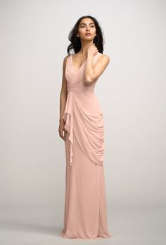 """Brides.com: Chiffon Bridesmaid Dresses for Summer. Chiffon Bridesmaid Dress: Watters. Watters """"Violet"""" chiffon full-length V-neck dress with asymmetrical side drape in peach, $260, available at Weddington Way  See more Watters bridesmaid dresses."""