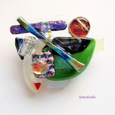 handcrafted original one-of-a-kind jewelry pin brooch of dichroic fused multicolored glass by Umeboshi Jewelry Designs