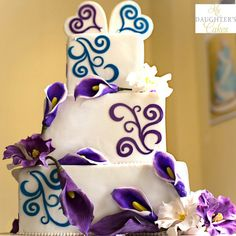 #Modern #weddingcake with purple and teal #scrolls by My Daughter's Cakes. Sugar flowers of picasso lilies, purple calla lilies and lisianthus. www.mydaughterscakes.com.  Photography by Picinich Photography