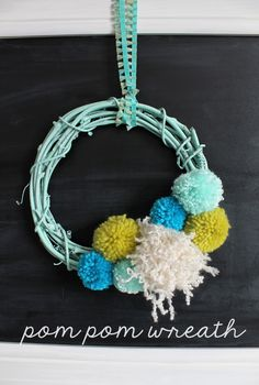 Spring up your décor with this cute and simple Pom Pom Wreath DIY!  Cute spring home decor idea.