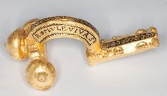 The gold fibula, presumably from Čentur near Koper, represents an exceptional find, not only due to its precious material, but also due to the inscriptions on the bow, celebrating Emperor Maxentius and his son Romulus. A replica of this fibula is on display at the Koper Regional Museum, whereas the original is kept at the museum Archäologische Staatssammlung München in Bavaria. Together with the previously discovered coin treasures from the same site, it bears witness to the military…
