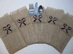 Add just the right touch of country to your reception table settings with these burlap silverware holders. This listing is for a set of 5 holders:  Each holder is 4 inches wide by 8.5 inches long and is adorned with a wooden heart and satin bow of your color choice. The wooden hearts can have your initial added to them at no extra charge. Just let me know at the time of purchase what initial youd like on them.  If youd like a ribbon color not listed, just convo me and Ill be more than happy…