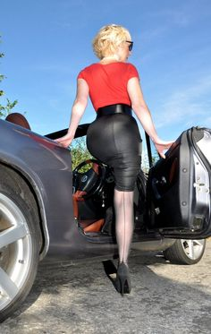 Visible Garter Bumps Under Tight Black Pencil Skirt Wide Black Belt Red Top Sheer Black Back Seam Stockings and Black High Heels
