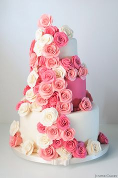 Pink Rose Festooned Wedding Cake - Pink Rose Festooned Wedding Cake - Layers of vanilla cake filled with white chocolate and vanilla pod buttercream. Ivory and cerise fondant, marzipan layer underneath the bottom tier's fondant covering covered with handmade sugar flowers.