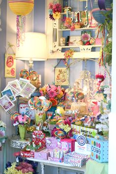 Summertime colorful candy and cupcake merchandising display at the shop.  www.violetcottage.com