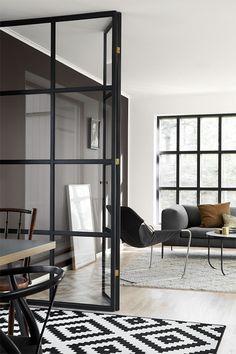 Grey walls, steel frame door and window. Via: Trendenser
