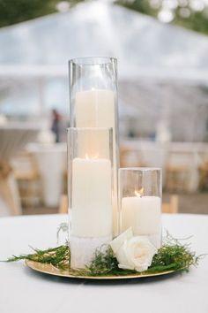 Chic white candle wedding reception centerpiece; Featured Photographer: Riverland Studios