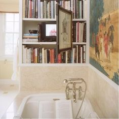 bookcase at end of bathroom with concealed television....are you KIDDING ME! WOO HOO!