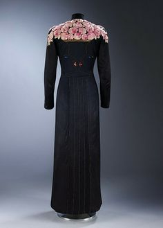 Evening coat for the Autumn 1937 collection by Elsa Schiaparelli inspired by two drawings of Jean Cocteau.