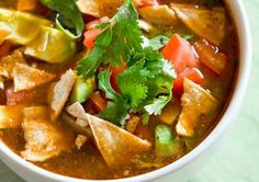 Crazy healthy chicken tortilla soup with avocado.