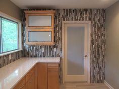 Verticle Tile Backsplash and floating cabinets! Designed by Carol Jameson CMKBD
