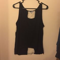 Black and cream tank Black tank with cream colored lace cross on back. Only worn once Charlotte Russe Tops Tank Tops