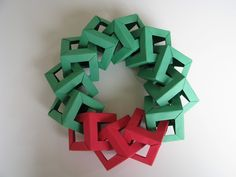 Stephen's Origami: Origami Christmas Decorations - Origami Wreath . http://stephensorigami.blogspot.com/2010/12/origami-christmas-decorations-origami.html #unitorigami  origami Christmas tree tutorial: http://stephensorigami.blogspot.com/2010/12/origami-christmas-tree-tutorial.html Origami Magic Stars: http://stephensorigami.blogspot.com/2012/02/more-oriland-origami-magic-stars.html