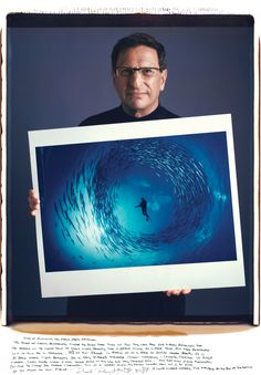 David Doubilet With his shot of a school of barracuda circling a naturalist in the Bismarck Sea off New Hanover island, in Papua, New Guinea, which first appeared in the April 1998 issue of National Geographic.