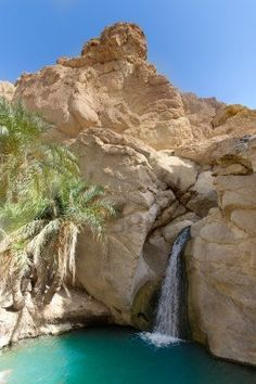 Waterfall in Oasis between the rocks tunisia. Panoramic view.