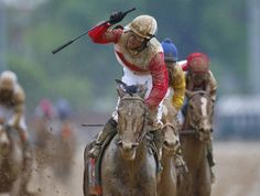 Jockey Joel Rosario celebrates after crossing the finish line first on Orb during the running of the 139th Kentucky Derby horse race at Churchill Downs in Louisville, Kentucky May 4, 2013. (Photo by Jeff Haynes/Reuters)