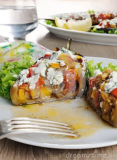 Stuffed eggplant with ricotta and vegetables in lettuce