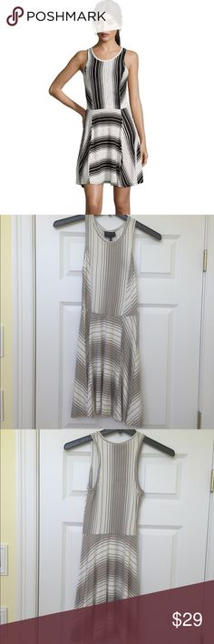 NWT Romeo + Juliet Couture Dress NWT Romeo + Juliet Couture Dress is a soft cotton/spandex mix. The asymmetrical design looks amazing on. This dress is a soft grey. Great for work or play. Looks adorable on. Smoke Free Home. Romeo & Juliet Couture Dresses