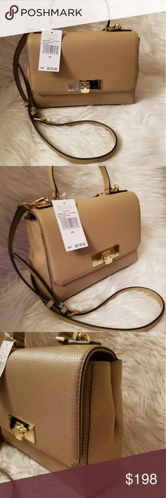 "NWT* Michael Kors Med. Callie Satchel* NWT*Michael Kors Callie Medium top handle Satchel / cross body bag.* Color: Dark camel Leather *Top handles with 7.5"" drop* *Removable cross body strap*Gold tone hardware* *Exterior feature one open pocket*Interior features 3 slip pockets , 1 back wall zip pocket and 1 key clip* Approx. Measurements: 10""L x 7""H x 2.75""D* Reasonable offers accepted* Bundle & Save* Michael Kors Bags"