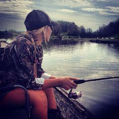 Just a girl enjoying the lake and fishing.