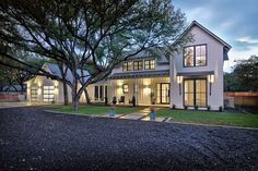 Modern Farmhouse Exterior With Gravel Driveway Board And Batten