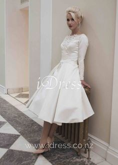 Vintage and elegant, this ivory bridal dress is a sumptuous satin gown. A short satin tea length wedding dress with long fitted sleeves. The neck is decorated with guipure lace over a sheer V neckline. Guipure lace also finishes the back and cuffs to add Lace Wedding Dress With Sleeves, Tea Length Wedding Dress, Long Sleeve Wedding, Tea Length Dresses, Dresses With Sleeves, Full Sleeves, Lace Sleeves, Wedding Dresses 2014, Cheap Wedding Dress