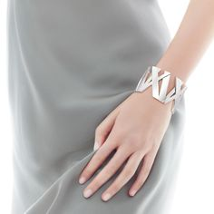 Blogger Lisa Dengler paired a sleek silver Atlas® cuff with soft gray. #Atlas #silver #TiffanyPinterest