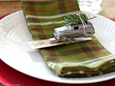 Use toy cars and clothespins to make these DIY place card holders! Faux mercury glass adds a metallic touch to your holiday table.