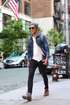 Pair a navy denim jacket and black jeans to get a laid-back yet stylish look. Keep it matchy-matchy with brown suede desert boots.  Shop this look for $238:  http://lookastic.com/men/looks/beanie-and-backpack-and-v-neck-t-shirt-and-denim-jacket-and-jeans-and-desert-boots/3796  — Grey Beanie  — Charcoal Canvas Backpack  — White V-neck T-shirt  — Navy Denim Jacket  — Black Jeans  — Brown Suede Desert Boots