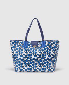 Shopping con estampado animal print azul