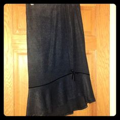 Zara charcoal skirt, velvet ribbon trim, hi lo hem Made and purchased in sunny Spain! Soft vicose with poly feels like softest flannel. Flirty black velvet ribbon circles the asymmetrical hem, ending at a dainty bow above the open slit. Gorgeous above black boots! Very rare item. Zara Skirts Midi