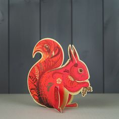 'Cyril Squirrel' by Sarah Young (A649). Die-cut fold-out greeting card reproduced from a print by Sarah Young. Supplied with a grey craft paper envelope. Published by Art Angels.