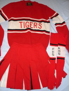 vintage cheerleading uniform catalogs for sale - Bing images Africa Burn, Band Uniforms, Baby Queen, Cheerleader Costume, Cheerleading Uniforms, Varsity Sweater, Retro Look, Playing Dress Up, Cheer Skirts