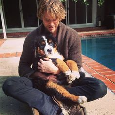AWE! Another cute photo of Eric Christian Olsen and his doggie!