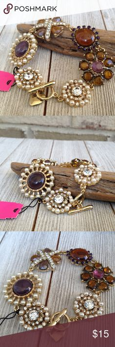Toffee Jewel Toned Bracelet Beautiful brown and toffee colored stones compose this Bracelet. T bar closure Jewelry Bracelets