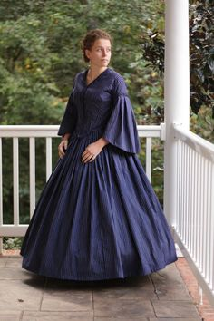 With winter events quickly approaching, a civil war dress is uniquely and elegantly suited for reenactments. Made with an elegant striped print, the dress features a bodice fitted with boning to give a finished look. The quality of fitting is raised due to the entire dress being lined. All seams on the inside are finished.  What you will need:  For period correctness, I recommend buying period correct undergarments. The model is wearing the correct undergarments and is made to fit with a…
