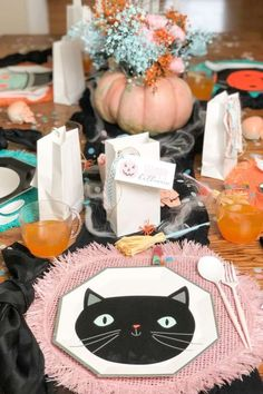 Feast your eyes on this chic colorful kids Halloween party! The table settings are awesome! See more party ideas and share yours at CatchMyParty.com #catchmyparty #partyideas #halloween #halloweenparty #bohohalloweenparty #kidshalloweenparty #boo #halloweentablesettings